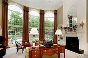 11235 Hunters Pond Road: The living room is two stories tall.
