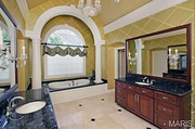 11235 Hunters Pond Road: Each of the six bedrooms has its own private bathroom.