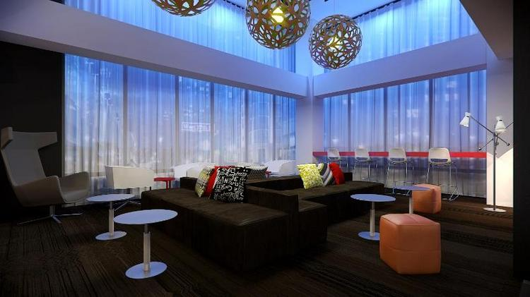 A rendering of the new lobby at the Brookshire Suites.
