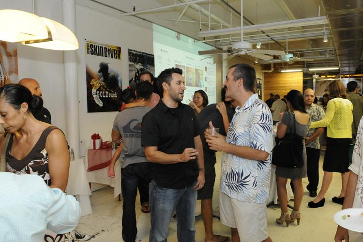 Mark Quezada, left, who founded the gift-giving website Minded with his wife, Tiffany, talks with entrepreneur Steve Cadotte, a member of the Hawaii Angels, at a party to launch the site at the Box Jelly in Honolulu.
