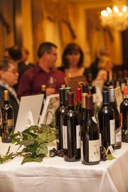 The silent auction featured many bottles of wine.