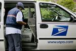 Revenue up, operating costs down, but Postal Service still loses money