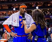 New York Knicks forward Carmelo Anthony is all smiles for the media after scoring 28 points in a win.