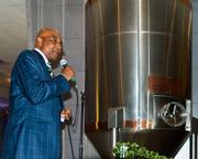 Fred Whitfield, president and chief operating officer for the Charlotte Bobcats, greets the crowd at the new Craft Beer Garden at Time Warner Cable Arena.