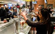 A bartender serves the growing crowd at the new Craft Beer Garden at Time Warner Cable Arena.