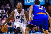 Charlotte Bobcats guard Kemba Walker tries to juke New York Knicks defender Pablo Prigioni. The Knicks beat the Bobcats 101-91 in Friday's game at Time Warner Cable Arena.