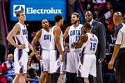 Charlotte Bobcats Cody Zeller, Gerald Henderson, Jeffery Taylor, Josh McRoberts and Kemba Walker take a breather during a timeout and confer with associate head coach Patrick Ewing.
