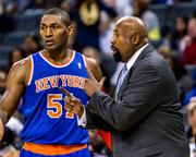 New York Knicks forward Metta World Peace confers with head coach Mike Woodson.