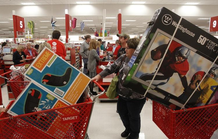 A shopper leaves a Dallas area Target store at  with two cartfuls of items on Black Friday in 2012. The Minneapolis-based retailer said it will open for Black Friday at 8 p.m. this Thanksgiving.