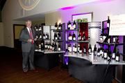 Wells Fargo executive vice president and region head Gary Orr admires a mountain of wine for a raffle prize at the American Leadership Forum awards.