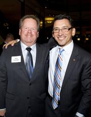 PG&E energy solutions and service manager Clay Schmidt and Solis Financial Strategies CEO Eric Solis pose at the American Leadership Forum awards dinner.
