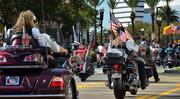 A group of bikers marches on the Independent Drive during the Jacksonville's Veterans Day Parade on Monday, Nov. 11, 2013.