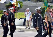 Members of a ROTC walks on the Independent Drive during the Jacksonville's Veterans Day Parade on Monday, Nov. 11, 2013.