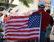 American flags are seen during the Jacksonville's Veterans Day Parade on Monday, Nov. 11, 2013.