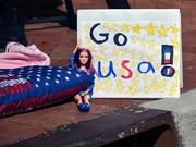 A hand-made sign is seen during the Jacksonville's Veterans Day Parade on Monday, Nov. 11, 2013.