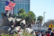 Participants of the Jacksonville's Veterans Day Parade ride the M4 Sherman tank during the Jacksonville's Veterans Day Parade on Monday, Nov. 11, 2013.