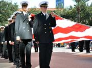 Participants of the Jacksonville's Veterans Day Parade hold the American flag during the parade on Monday, Nov. 11, 2013.