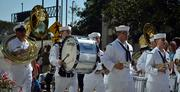 Members of a marching band walk on the Independent Drive during the Jacksonville's Veterans Day Parade on Monday, Nov. 11, 2013.
