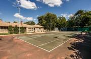 A tennis court at the Cottrell property in Old Preston Hollow.