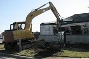 Darin Hall, vice president of real estate development for the Port Authority, used an excavator to start demolition of a vacant restaurant on the site.