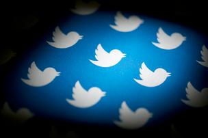 Twitter Inc. logos are arranged for a photograph in Washington, D.C., U.S., on Friday, Sept. 13, 2013.