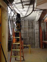 One of Quaintance-Weaver's in-house construction workers handles wiring for what will be the new lower-level lobby at the O.Henry Hotel.