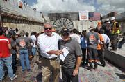 PortMiami Director Bill Johnson and Louis Brais, president and CEO of Bouygues Civil Works Florida, celebrate the tunnel machine breaking through on building the first tube.