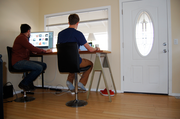 At first, working out of the house was more of a makeshift endeavor, with laptops on laps. Now the team members have standing desks that were made from old doors and other reclaimed materials from the ReBuilding Center on North Mississippi Ave. All told, the group built their desks for $38.