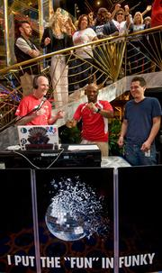 Gov. Rick Scott helps Carnival Cruise Lines' disc jockey Ro Parrish entertain passengers onboard the Carnival Imagination during a 2011 visit to PortMiami.