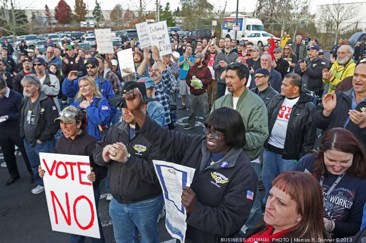 Hundreds of Machinists rally against Boeing's proposed labor contract at the International Association of Machinists & Aerospace Workers Local 751 union hall in Everett.  The machinists vote Wednesday on a Boeing  offer to build the 777X in the Puget Sound in exchange for labor contract concessions.