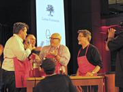 Celebrity judges Todd English, left, Tom Colicchio, center and Rick Bayless, right, talk some trash during the judges competition.