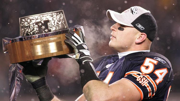 Chicago Bears linebacker Brian Urlacher holds the George Halas trophy after the Chicago Bears defeated the New Orleans Saints to win the NFC Championship in Chicago, Jan. 21, 2007.