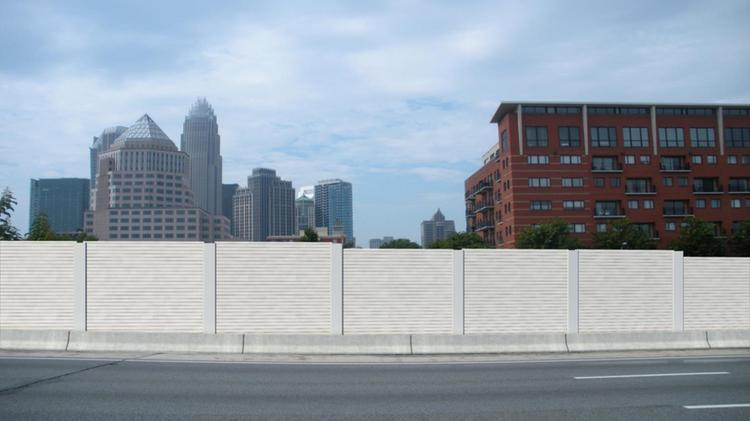 Shown here is a rendering of noise walls proposed to blunt highway traffic sound along Interstate 277at Church Street in uptown Charlotte.