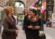 """From left, """"Washington Business Report"""" anchor and reporter Rebecca Cooper, Fox 5's Sue Palka and WUSA9's Andrea Roane, at the Christmas tree."""