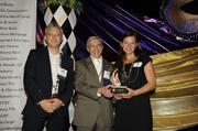 From left, Sagatov Associates President Yuri Sagatov, HomeAid Northern Virginia President Russell Rosenberger Jr. of Madison Homes Inc. and Caroline Jones of Doorways for Women and Families. Doorways won HomeAid's Nonprofit Service Provider Project of the Year Award.