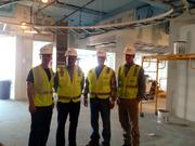 On Oct. 29, the staff of LM&O Advertising got a tour of their new headquarters, currently under construction at 1776 Wilson Blvd. in Arlington. From left, Scott Laughlin, Chris Laughlin, Dave Marinaccio, all of LM&O, and Greg Schwartz of Skanska review the build-out progress of the front lobby.