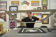 No. 3 Michaels Stores -- Matt Kuhns works to frame a picture in the Irving store. The Irving-based arts and crafts retailer announced plans for an IPO in March 2012 and delayed plans as its former CEO recovered from a stroke. The company had $4.408 billion in revenue in 2012.