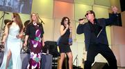 Singer Jim Belushi, right, performs with unidentified female guests he pulled onto the stage at the Washington Convention Center on March 23. The event was a fundraiser for the Leukemia and Lymphoma Society.