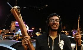 Mathew Kumar shows off a crossbow made by Texas-based Iolo, following Fantastic Arcade 2012. The crossbow, which his friends won at the event was once owned by gaming entrepreneur and space tourist, Richard Garriott.
