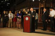 """Mayor Buddy Dyer prepares the audience for the illumination of the Tower of Light, which he acknowledges was never """"officially"""" lit since 1992."""