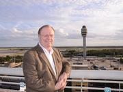 GOAA Chairman Frank Kruppenbacher overlooking the control tower and airline gates from the roof of the OIA parking garage.