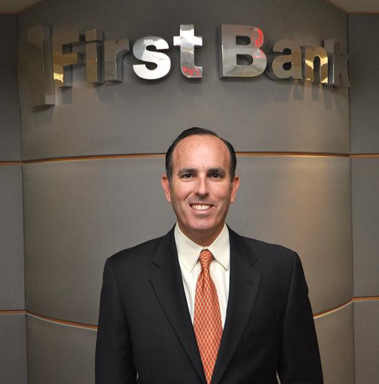 First Bank of Florida hired Calixto Garcia-Velez in March 2009. It has since made progress under his leadership.
