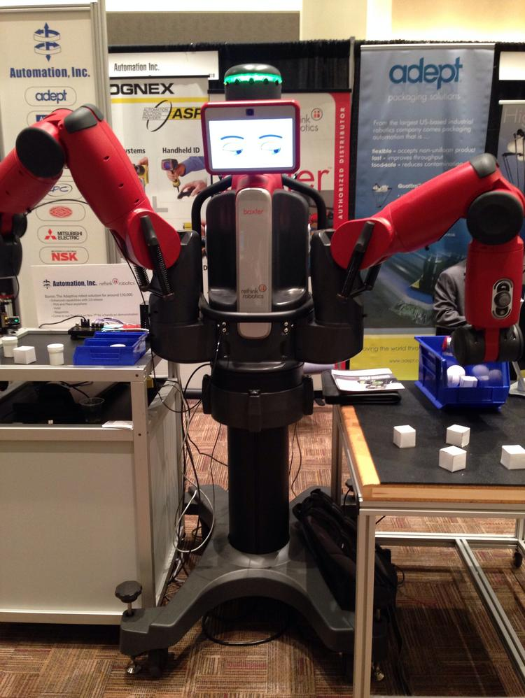 A front view of Baxter, a robot developed by Rethink Robotics and distributed locally by Automation Inc. Baxter the manufacturing robot is now faster, more precise and easier to use thanks to a new software update.