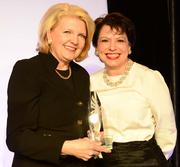 Debra Cannon,  with the Cecil B. Day School of Hospitality at Georgia State University, receives the ACVB award from Nancy Oswald, ACVB chair of the board.