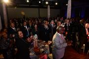 Attendees applaud the inductees.