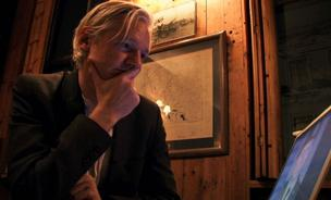Julian Assange is seen in