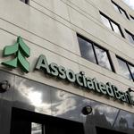 Associated Bank to close 13 branches while profits rise
