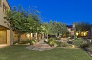 The home has numerous gardens and patios.