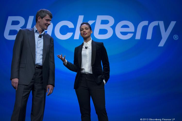 Alicia Keys, global creative director for BlackBerry, right, speaks while Thorsten Heins, chief executive officer of Research In Motion Ltd. (RIM), listens during the launch of the BlackBerry 10 in New York, U.S., on Wednesday, Jan. 30, 2013. Research In Motion Ltd., taking the name of its best-known product, will now be known simply as BlackBerry, part of a comeback plan that includes unveiling a redesigned line of smartphones today. Photographer: Scott Eells/Bloomberg *** Local Caption *** Alicia Keys; Thorsten Heins