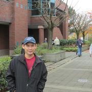 Duc Nguyen, after voting against Boeing's contract proposal at union headquarters, behind, said he doesn't think the deal would provide well for future workers.